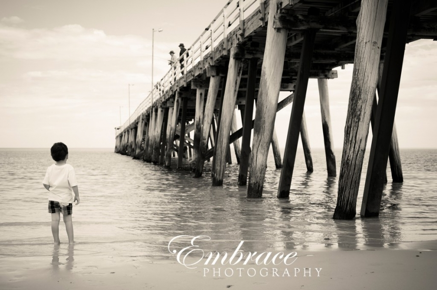 Boy beach jetty adelaide family photographer embrace photography